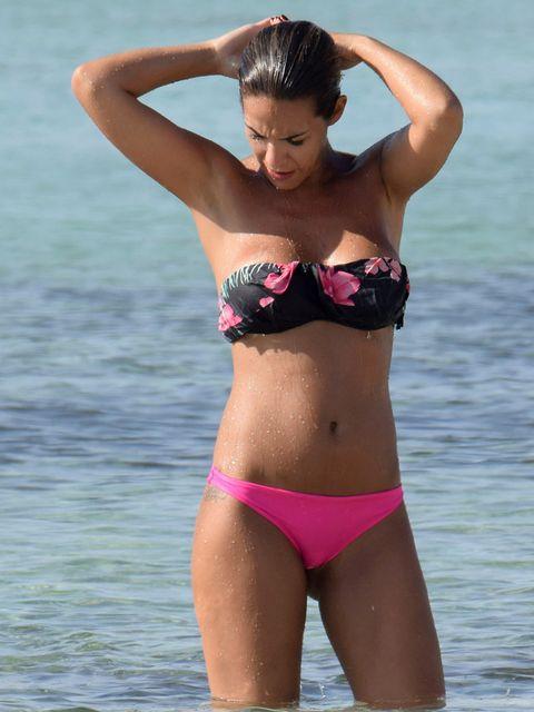 Bikini, Swimwear, Clothing, Undergarment, Swimsuit top, Lingerie, Swimsuit bottom, Model, Beauty, Stomach,