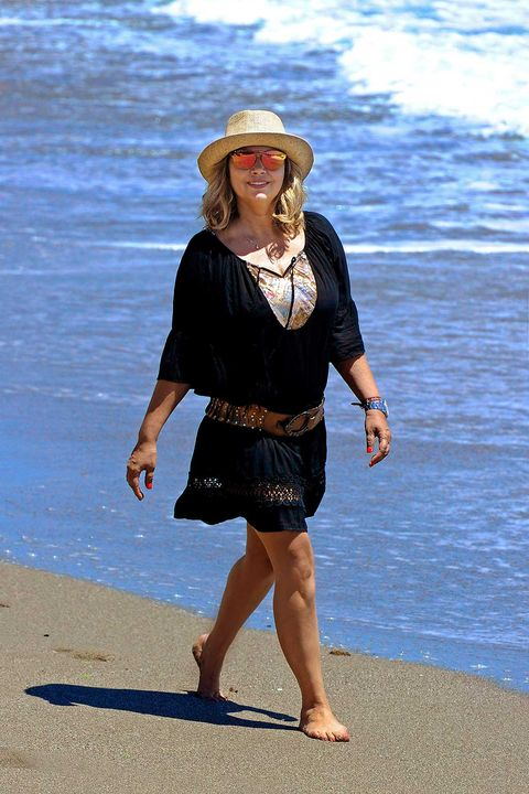 Clothing, Hat, Shoulder, People in nature, Summer, Sun hat, Waist, Fashion accessory, Headgear, People on beach,