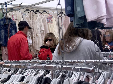 Public space, Textile, Retail, Marketplace, Market, Sunglasses, Bazaar, Human settlement, Clothes hanger, Trade,