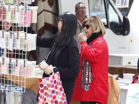 Eyewear, Vision care, Sunglasses, Bag, Jacket, Luggage and bags, Vehicle door, Shopping, Service, Street fashion,
