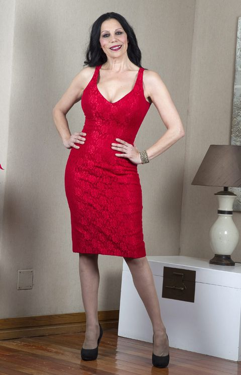 Dress, Sleeve, Shoe, Shoulder, Human leg, Standing, Joint, Red, One-piece garment, Style,