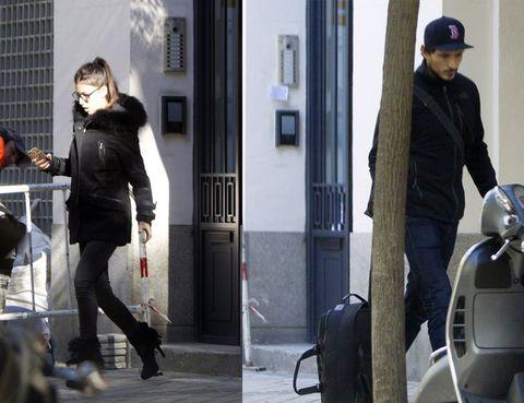 Leg, Cap, Human body, Jacket, Outerwear, Coat, Style, Street fashion, Guitar, Street,