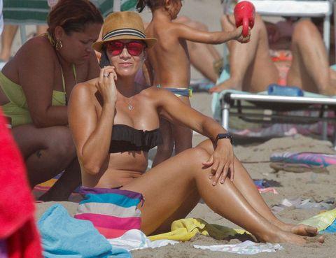 Eyewear, Fun, Brassiere, Human leg, Summer, Sun tanning, Hat, Undergarment, Chest, Vacation,