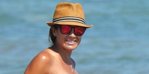 Clothing, Eyewear, Glasses, Vision care, Brassiere, Hairstyle, Skin, Hat, Sunglasses, Swimwear,