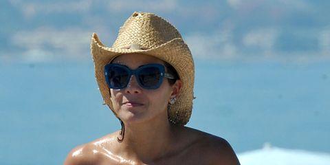 Clothing, Eyewear, Glasses, Vision care, Skin, Sunglasses, Hat, Shoulder, Summer, Strapless dress,