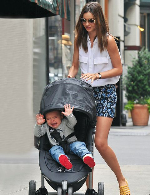 Clothing, Nose, Arm, Product, Flowerpot, Outerwear, Style, Baby carriage, Baby Products, Bag,