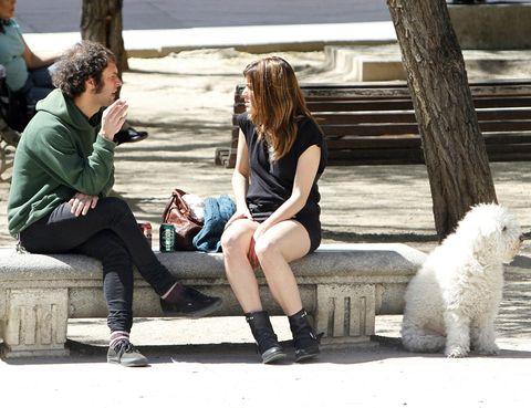 Clothing, Leg, Trousers, Sitting, Human body, Dog, Shoe, Outerwear, Human leg, Mammal,