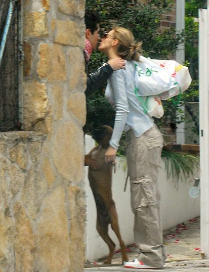 Human, Human body, Mammal, Interaction, Temple, Bag, Street fashion, Romance, Love, Stone wall,