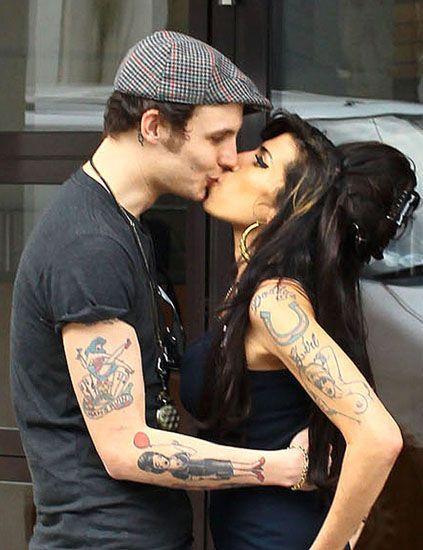 Ear, Cap, Tattoo, Interaction, Romance, Neck, Black hair, Kiss, Love, Baseball cap,