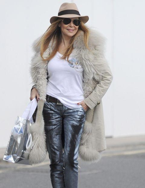 Clothing, Eyewear, Hat, Sleeve, Denim, Trousers, Human body, Jeans, Textile, Sunglasses,