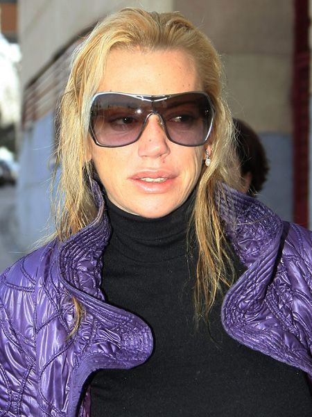 Eyewear, Vision care, Glasses, Mouth, Goggles, Outerwear, Sunglasses, Purple, Jacket, Street fashion,