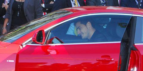 Automotive design, Vehicle, Land vehicle, Car, Red, Performance car, Vehicle door, Sports car, Luxury vehicle, Personal luxury car,