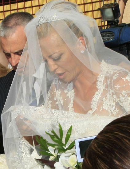 Bridal veil, Veil, Bridal clothing, Forehead, Eyebrow, Bridal accessory, Photograph, Petal, Wedding dress, Bride,