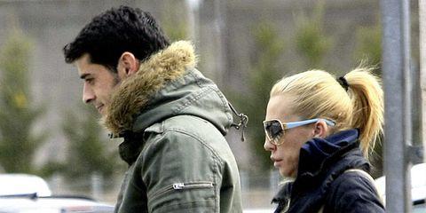 Human, Winter, Human body, Jacket, Outerwear, Coat, Street fashion, Parka, Earrings, Fur,