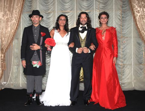 Trousers, Event, Hat, Textile, Coat, Interior design, Dress, Formal wear, Curtain, Gown,