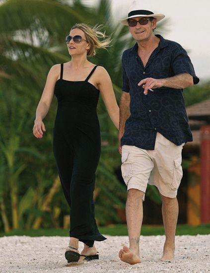 Eyewear, Hat, Sunglasses, Dress, Standing, Human leg, People in nature, Summer, Waist, One-piece garment,