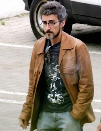 Jacket, Sleeve, Shirt, Textile, Photograph, Automotive tire, Outerwear, Denim, Standing, Collar,