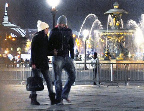 Human body, Fountain, Water feature, Jacket, Luggage and bags, Midnight, Street light, Baggage,