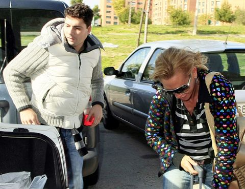 Motor vehicle, Glasses, Mouth, Land vehicle, Vehicle door, Automotive exterior, Car, Fender, Sunglasses, Street fashion,