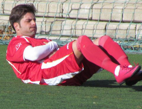 Grass, Sports uniform, Human leg, Jersey, Sportswear, Sock, Uniform, Playing sports, Carmine, Player,