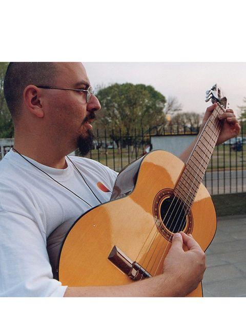 String instrument, Musical instrument, String instrument, Glasses, Plucked string instruments, Finger, Acoustic guitar, Guitar, Musical instrument accessory, Musician,