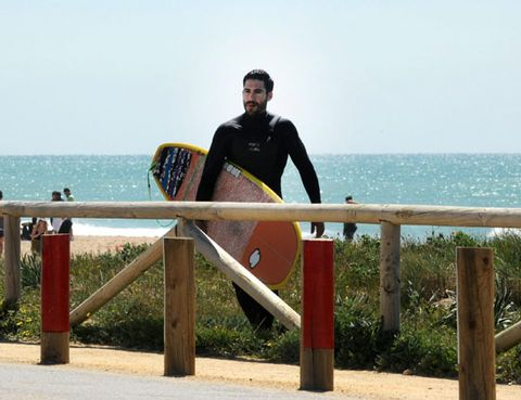 Surfboard, Surfing Equipment, Leisure, Coastal and oceanic landforms, People in nature, Vacation, Personal protective equipment, Ocean, Surface water sports, Boardsport,