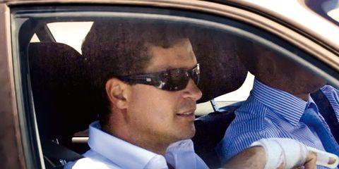 Eyewear, Motor vehicle, Vision care, Goggles, Sunglasses, Dress shirt, Collar, Vehicle door, Car seat, Travel,