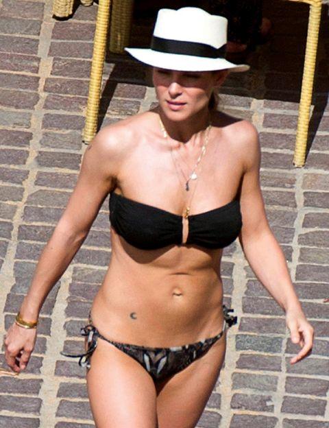 Clothing, Hat, Brassiere, Skin, Shoulder, Chest, Joint, Trunk, Undergarment, Abdomen,