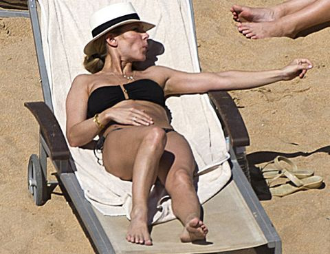 Leg, Hat, Human leg, Joint, Sitting, Summer, Sun hat, Comfort, Toe, Vacation,