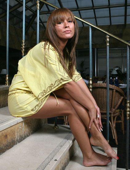 Clothing, Human leg, Sitting, Foot, Street fashion, Beauty, Knee, Thigh, Long hair, Bangs,