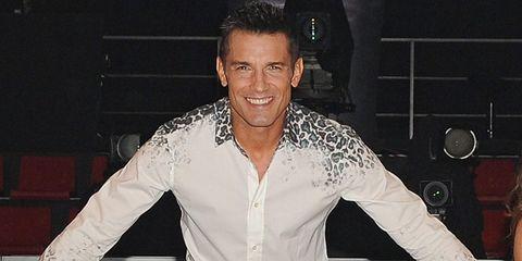 Dress shirt, Collar, Shirt, Style, Fashion, Thumb, Suit trousers, Gesture, Carpet, Pocket,