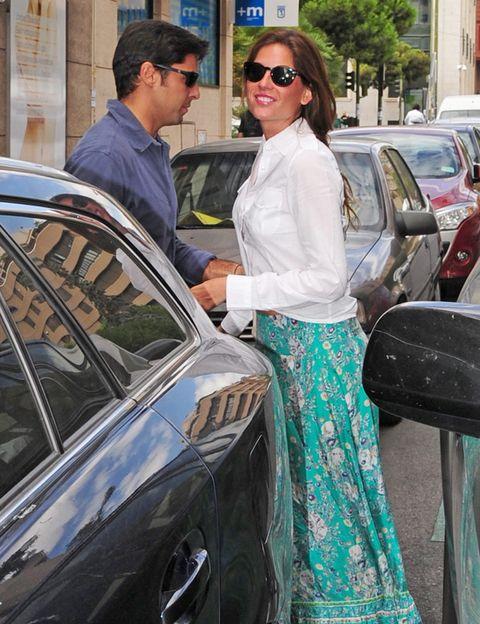 Eyewear, Glasses, Vision care, Land vehicle, Sunglasses, Shirt, Car, Street fashion, Vehicle door, Personal luxury car,