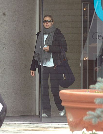 Outerwear, Standing, Flowerpot, Bag, Street fashion, Sunglasses, Luggage and bags, Grey, Pocket, Dress shoe,