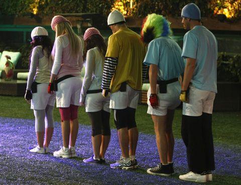 Footwear, Green, Hat, Leisure, Shorts, Sun hat, Back, Fedora, Bermuda shorts, Umbrella,