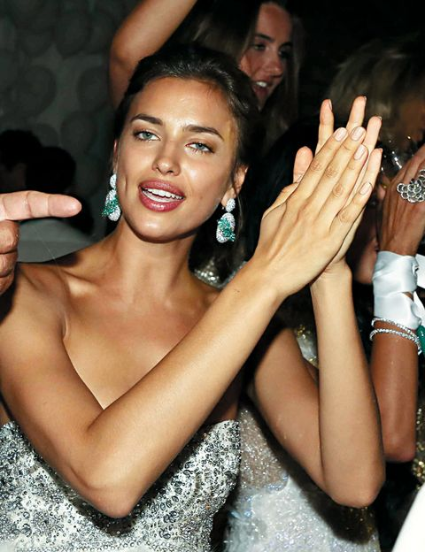 Face, Arm, Finger, Mouth, Earrings, Wrist, Hand, Fashion accessory, Dress, Thumb,