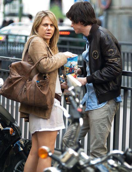 Coat, Outerwear, Jacket, Bag, Street fashion, Luggage and bags, Conversation, Brown hair, Blond, Handbag,