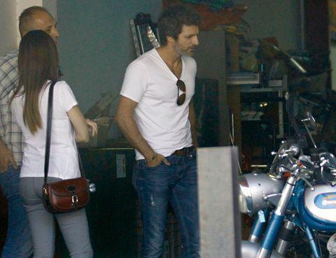 Motorcycle, Trousers, Denim, Jeans, Shirt, Bag, Fender, T-shirt, Fashion accessory, Pocket,