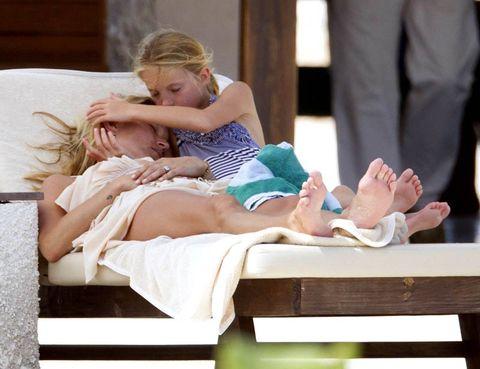 Comfort, Hand, Sitting, Knee, Blond, Lap, Love, Foot, Outdoor furniture, Barefoot,