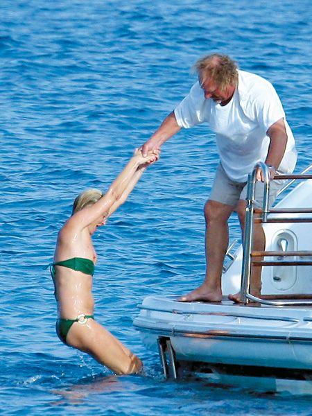 Water, Elbow, Leisure, Mammal, Summer, Watercraft, Vacation, Swimwear, Muscle, Undergarment,