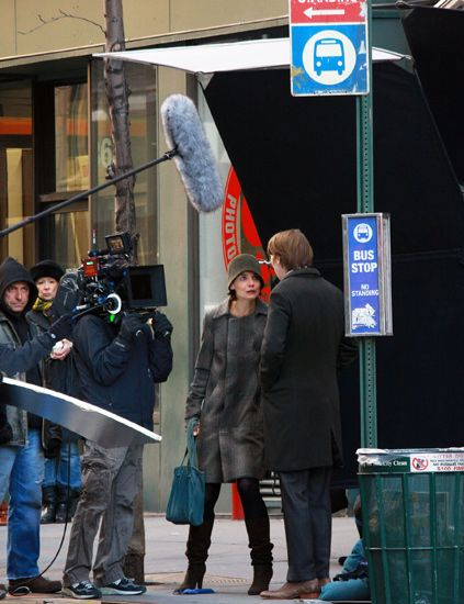 Coat, Jeans, Jacket, Winter, Video camera, Camera, Television crew, Luggage and bags, Street fashion, Snapshot,