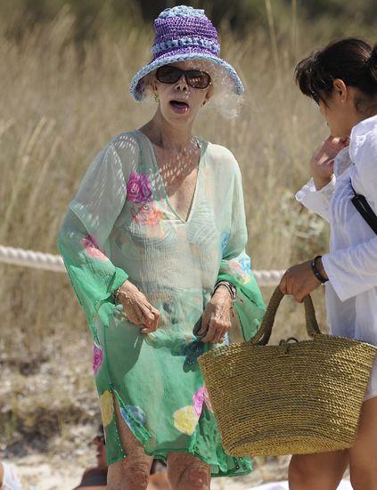 Eyewear, Sunglasses, Hat, Fashion accessory, Sun hat, Dress, Bag, Headgear, Costume accessory, Necklace,