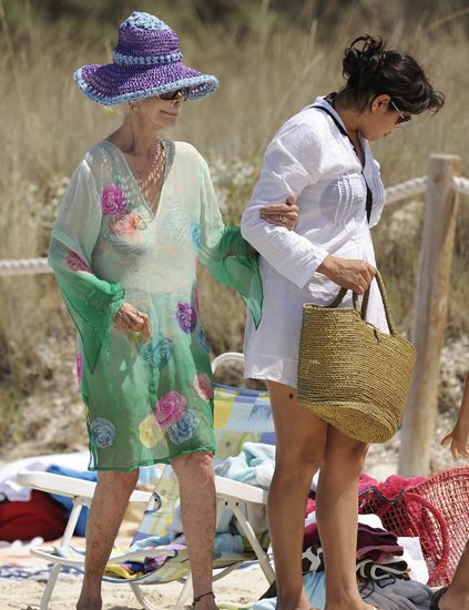 Clothing, Hat, Bag, Slipper, Sun hat, People in nature, Fashion, Luggage and bags, Sandal, Street fashion,