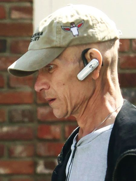 Cap, Audio equipment, Chin, Forehead, Brick, Brickwork, Headgear, Cool, Neck, Baseball cap,