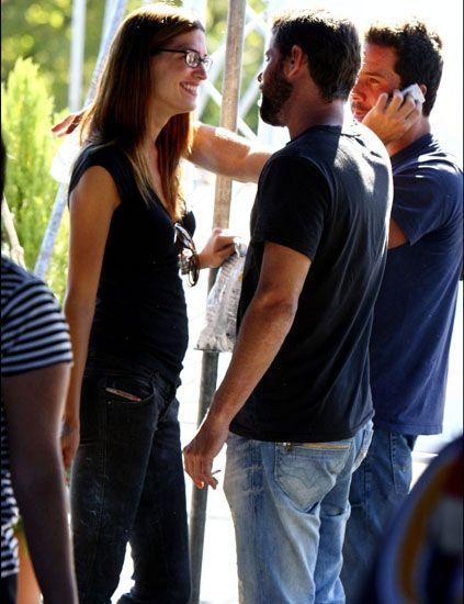 Denim, Trousers, Jeans, Shoulder, T-shirt, Interaction, Waist, Trunk, Conversation, Street fashion,