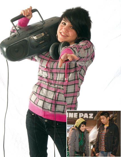 Sleeve, Textile, Jacket, Pink, Cameras & optics, Magenta, Digital camera, Denim, Camera, Film camera,