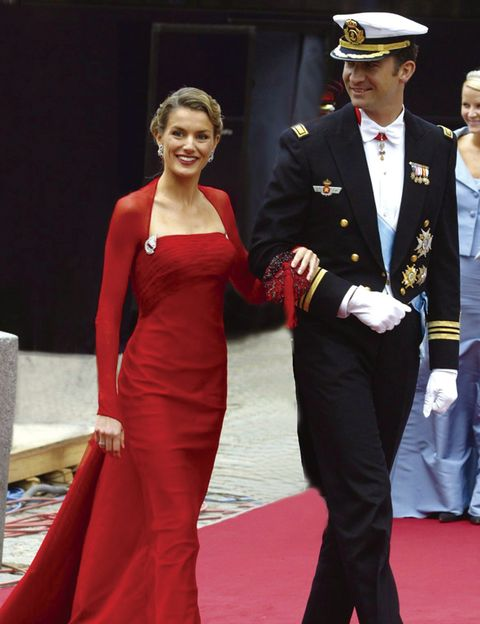 Dress, Coat, Outerwear, Hat, Cap, Red, Formal wear, Flooring, Style, Fashion accessory,