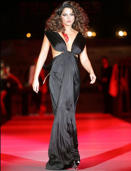 Hairstyle, Shoulder, Dress, Fashion model, Style, Formal wear, Fashion show, Fashion, Lipstick, Long hair,