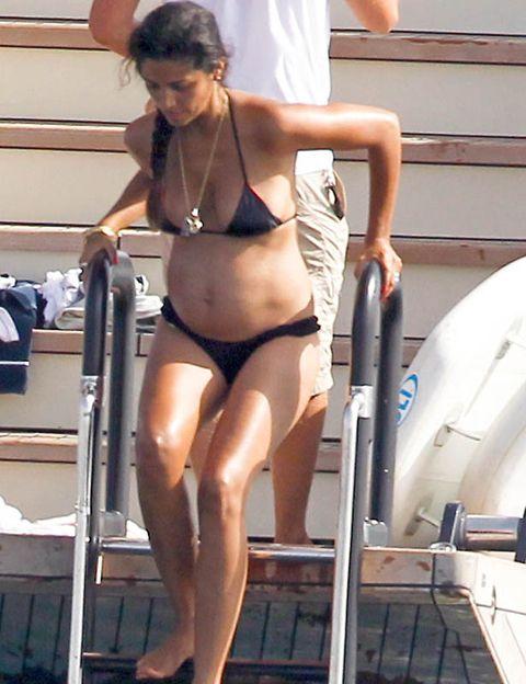 Leg, Human leg, Brassiere, Shoulder, Swimwear, Joint, Chest, Undergarment, Thigh, Swimsuit top,