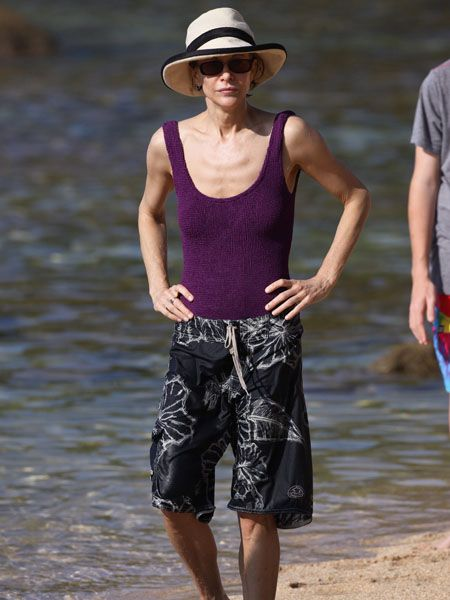 Hat, Sleeveless shirt, People in nature, Summer, Headgear, Shorts, board short, Waist, Sun hat, Fashion accessory,