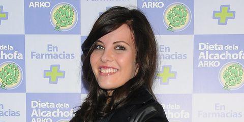 Green, Hairstyle, Eyebrow, Jacket, Style, Black hair, Eyelash, Logo, Leather jacket, Leather,
